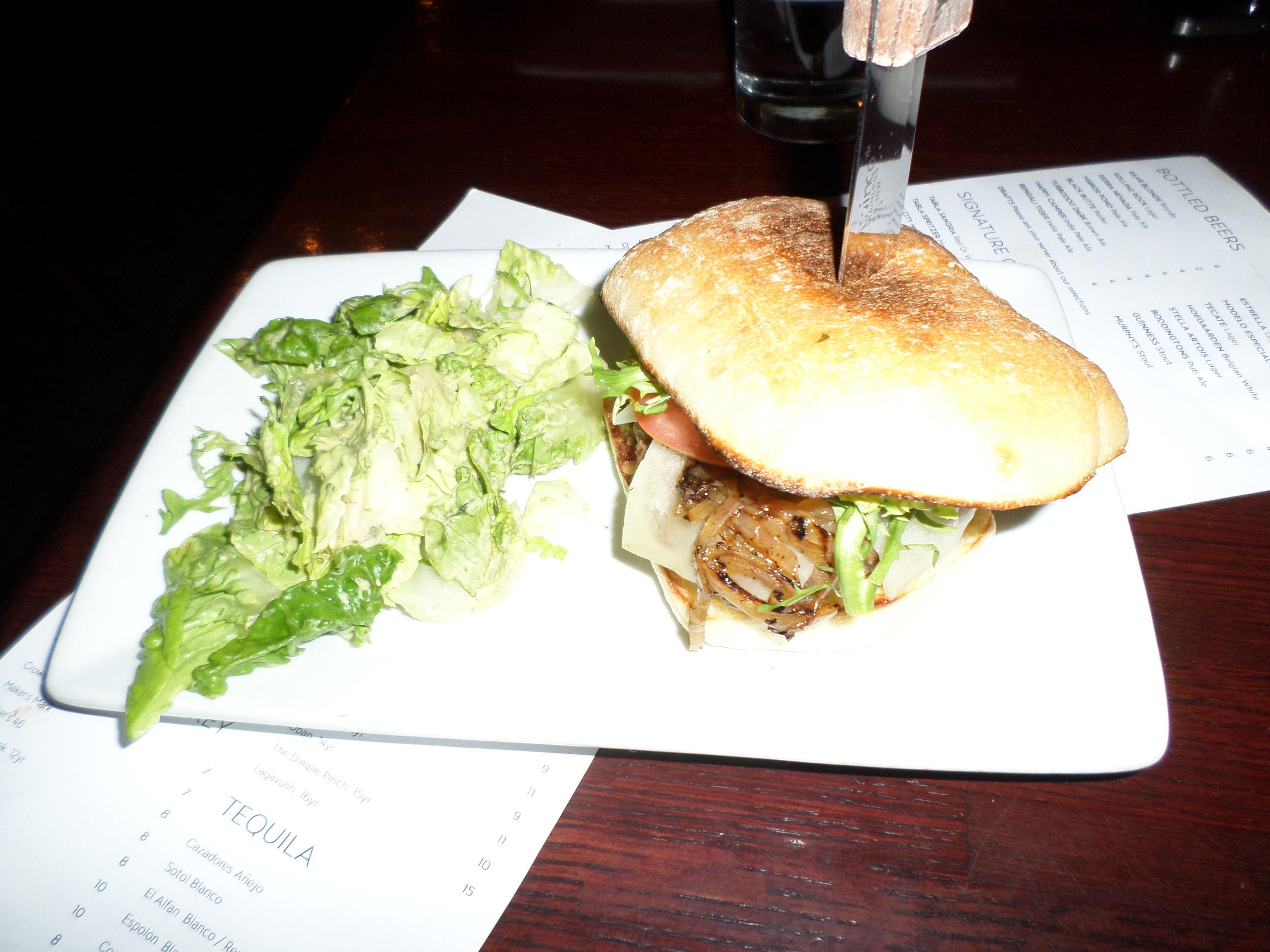 Tabla Restaurant has a great burger for $12. Cooked well without being burnt on the outsid
