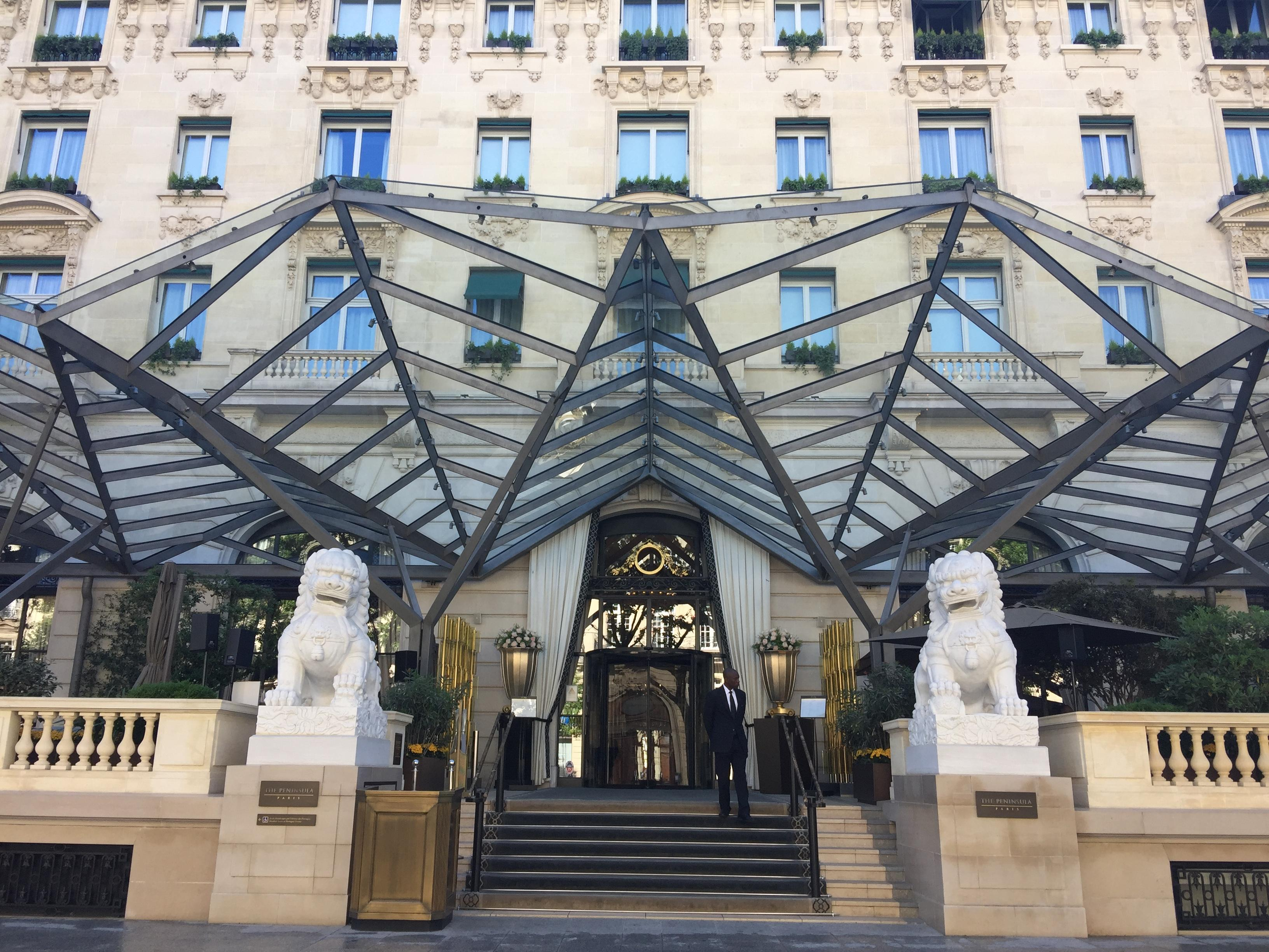 The entrance to the Peninsula Paris Hotel. Old meets new in architecture.