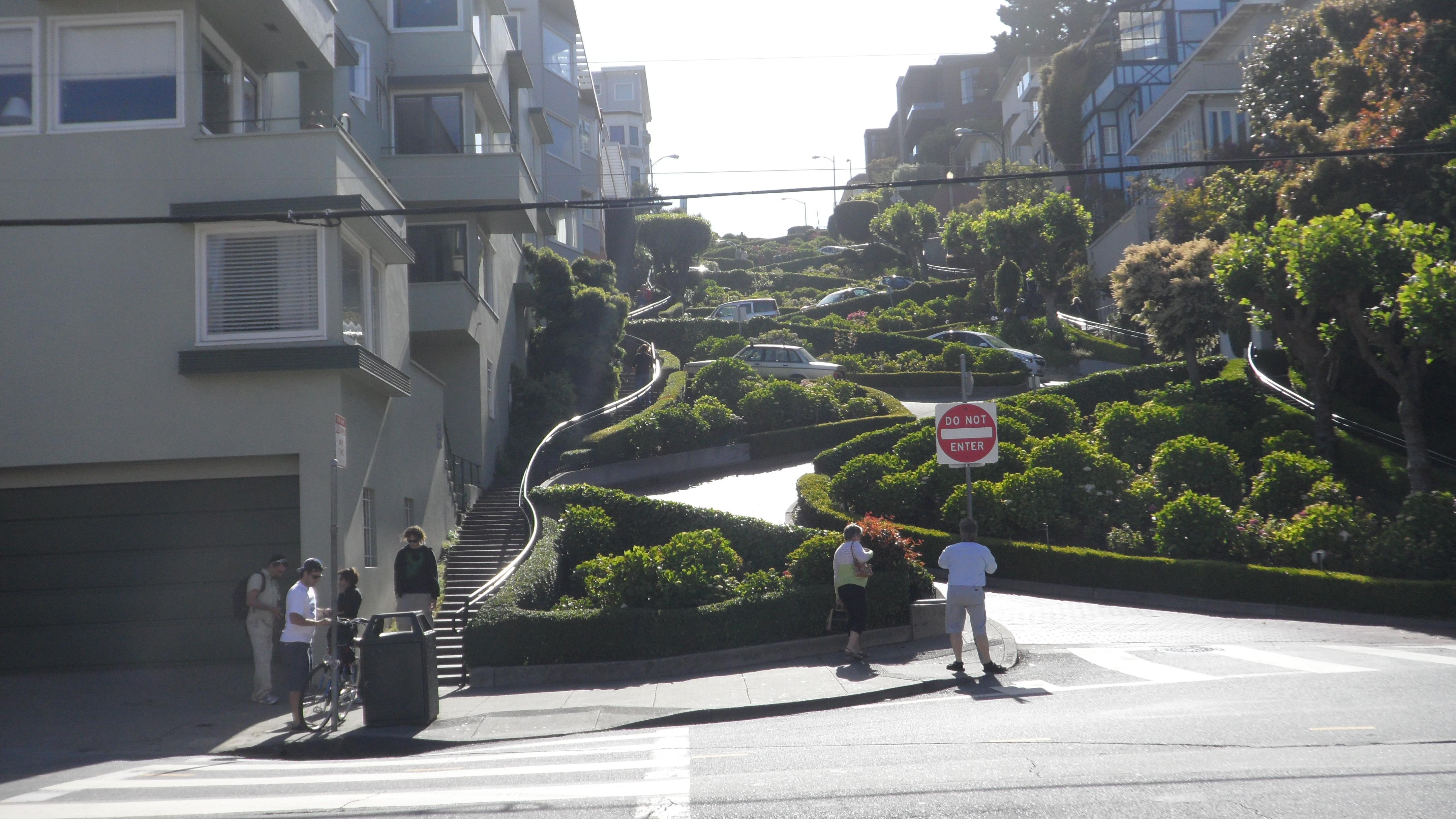 Lombard Street from the base looking up. A winding  one way road downhill in San Francisco
