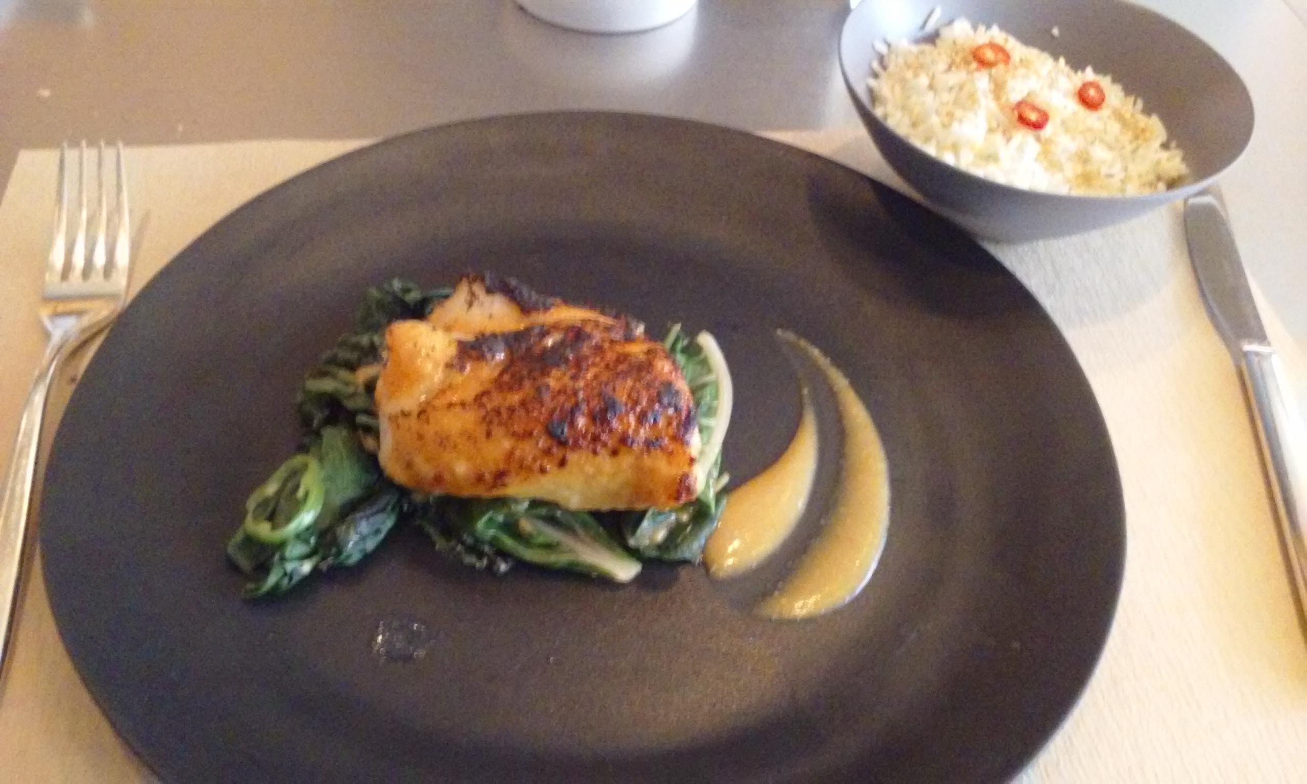 Hake at Jean Georges Nougatine. Cod. Excellent glaze but burned on the top. Bed of vegetab