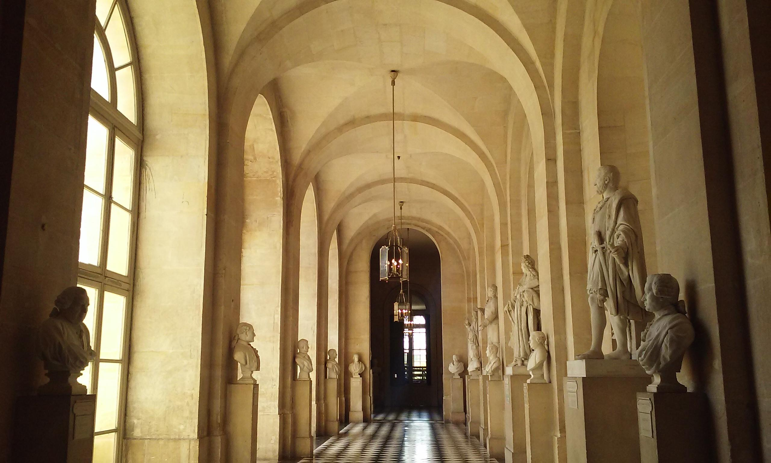 Hall of statues at Versailles. Includes statues of Kings and philosophers.