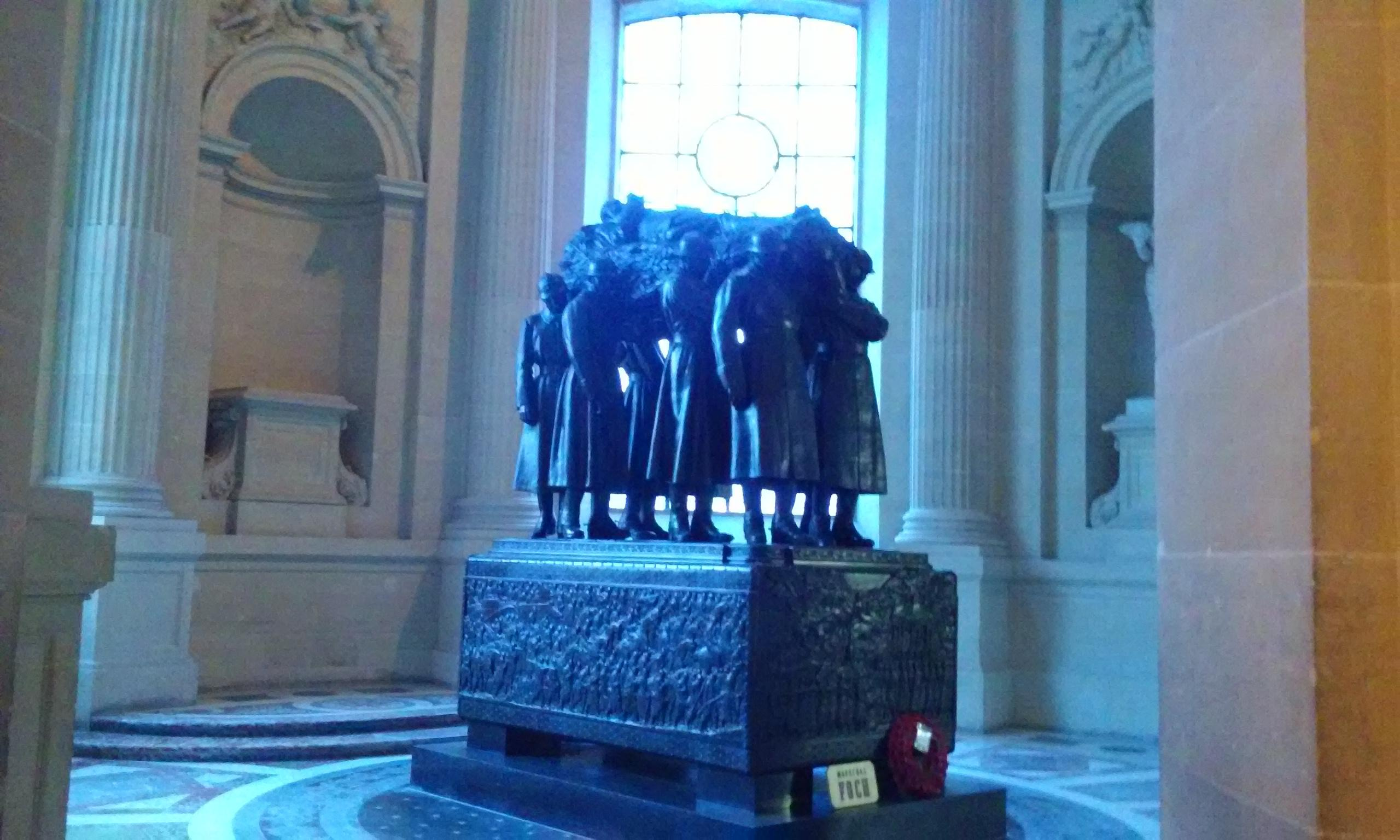Napoleon's Tomb. A statue of 8 men carrying a casket. Each area of Napoleon's tomb