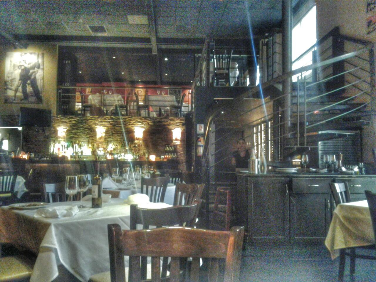 Garufas Argentine restaurant. Nice interior with paintings and sculptures. Reasonable menu