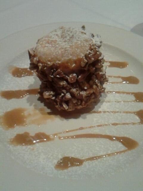 Alfajor at Garufas. #food  pecans on the outside, flaky pastry with caramel on the inside.