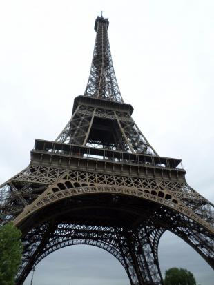Looking up at the Eiffel Tower from the base.