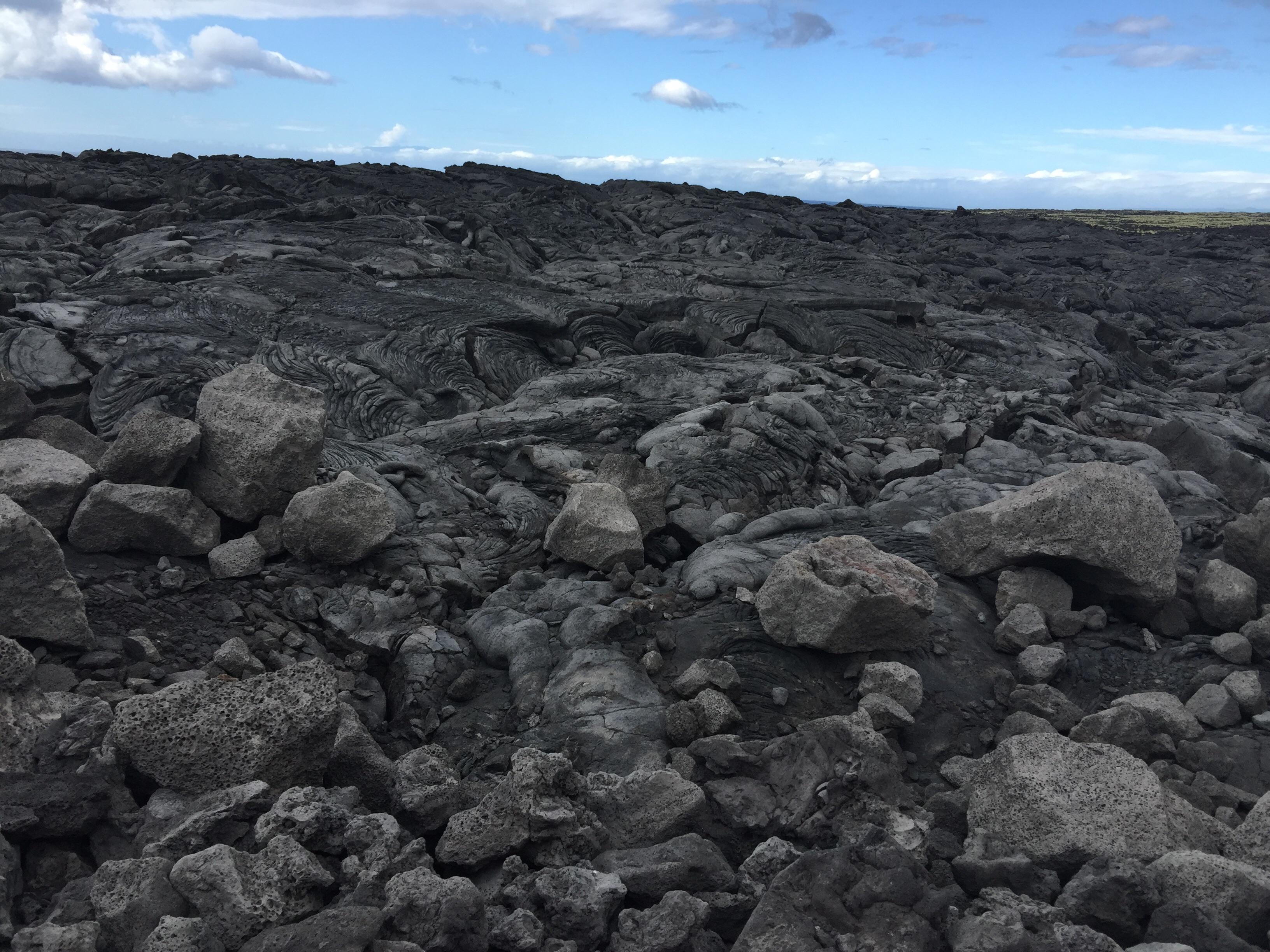 Kekaha Kai Beach park. All lava rock on a rough road which would be best traversed with a