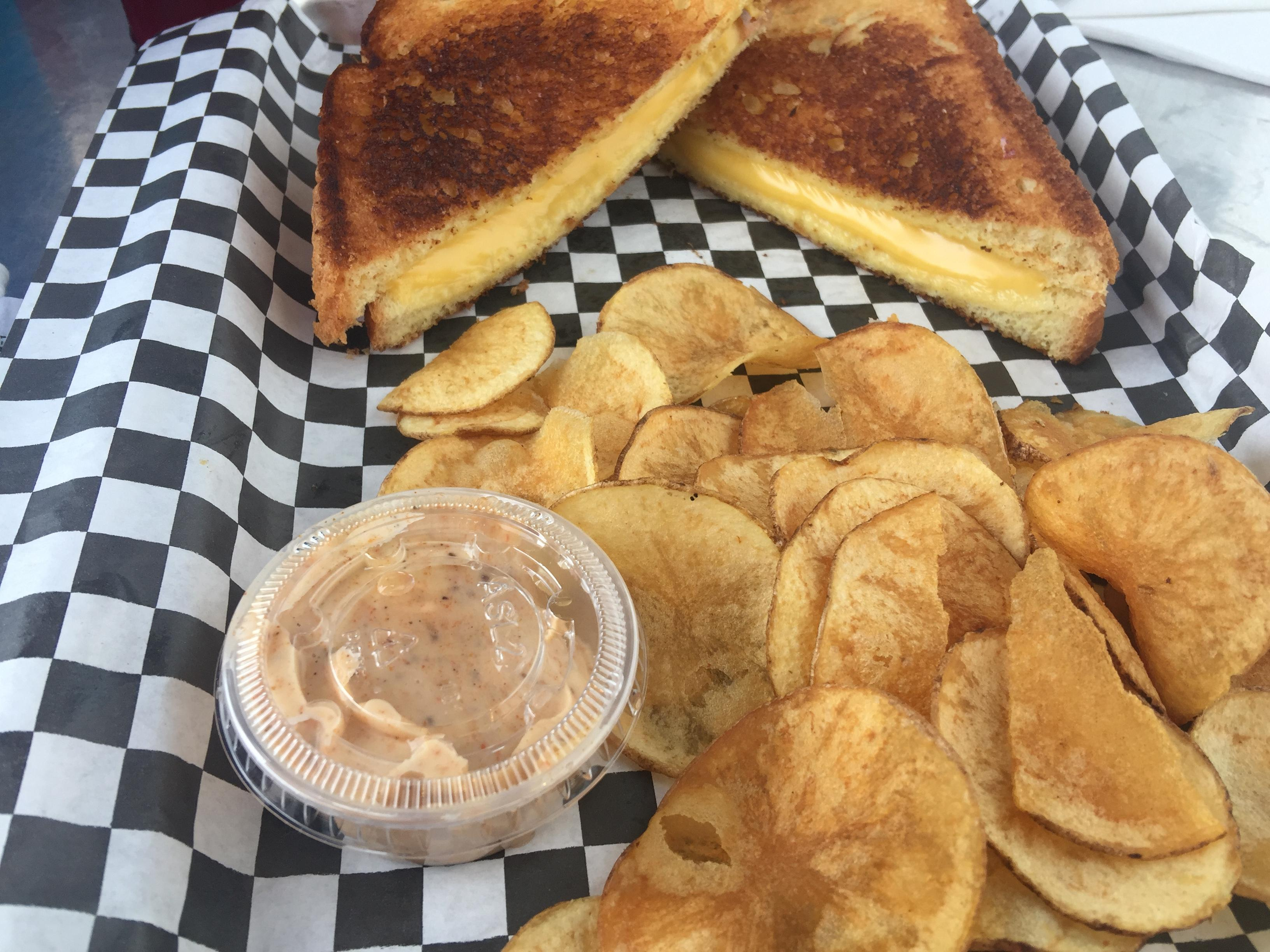 Grilled cheese sandwich with chips at Oceans 13 $7 2018. Fries are better. #food