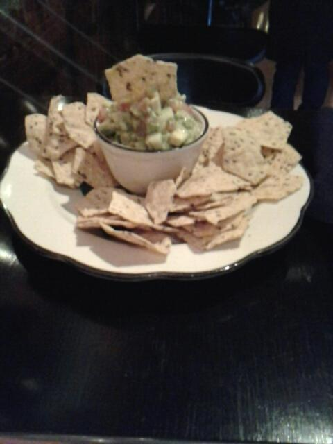 Guacamole # food  at  Eloise $10  tangy.  served with multigrain  chips.